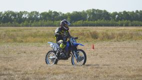 Enduro racer rides a motocross bike. Samara, Russia - September 11, 2018: Training motorcycle rider of the Samara motor club. Enduro racer rides a motocross bike stock video footage