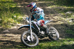 Enduro racer is riding through the woods Royalty Free Stock Photo