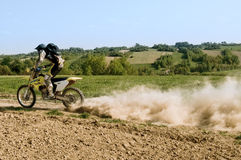 Enduro Rider. An enduro rider fast moving  on motocross Royalty Free Stock Photos