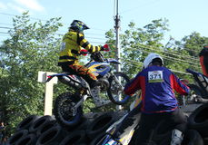 Enduro rider on car tires Royalty Free Stock Photography