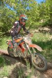 Enduro rider at motocross competition Royalty Free Stock Image