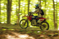 Endurocross speeding in forest Royalty Free Stock Photo
