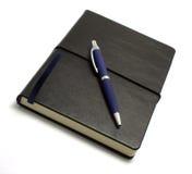Enegreça o caderno com pena Foto de Stock Royalty Free