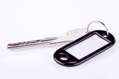 Enegreça o Tag chave em branco Fotografia de Stock Royalty Free