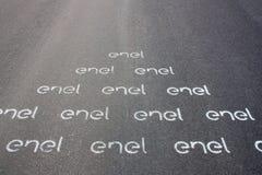 ENEL van het machtsbedrijf embleem op het asfalt wordt geschilderd dat royalty-vrije stock afbeelding