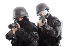 Enemies. Shot of a soldier holding gun Stock Image