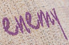 Enemy Writing Macro. Enemy writing sewn on fabric royalty free stock image