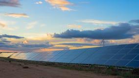 Energías renovables en la puesta del sol IV Foto de archivo