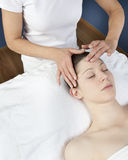 Energetic acupressure face massage royalty free stock photography
