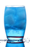 Energetic blue drink. Chilled glass of energetic blue drink stock image