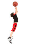 Energetic Boy Child Jumping With Basketball Royalty Free Stock Photo