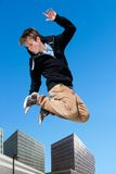 Energetic boy jumping in city. Royalty Free Stock Photo