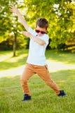 Energetic boy in sunglasses dancing in summer. Portrait of energetic little boy wearing sunglasses dancing in summer stock images