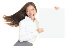 Energetic business woman showing sign. Energetic portrait of young businesswoman holding a blank empty poster with copy space. Beautiful young smiling woman royalty free stock photos