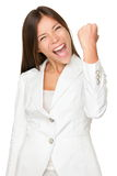 Energetic Businesswoman Clenching Fist. Portrait of energetic young businesswoman clenching fist isolated over white background stock photo