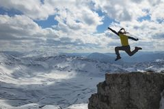 Energetic, dynamic and enthusiastic people in the mountains. Energetic, cheerful and happy climber in the mountains stock photography