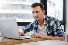 Energetic committed student searching for something online Stock Images