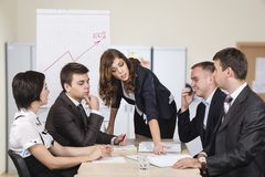 Energetic corporate manager instructs her team Stock Photo