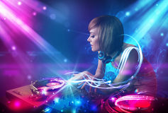 Energetic Dj girl mixing music Royalty Free Stock Images