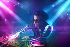 Energetic Dj mixing music with powerful light effects Stock Image
