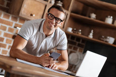 Energetic enterprising man receiving a message from employer. Checking mail. Smart dedicated motivated guy communicating with his boss per phone and email while Royalty Free Stock Photos