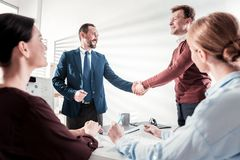 Energetic four colleagues finishing meeting stock photo