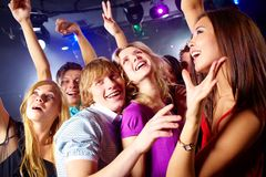Energetic friends. Photo of smiling friends dancing during the party in excitement stock photography