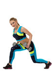Energetic girl actively exercising with dumbbells Royalty Free Stock Photo