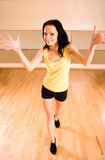 Energetic girl in a dance studio. Open position and smiling Royalty Free Stock Images
