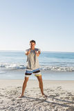 Energetic handsome man showing thumbs up to camera Royalty Free Stock Images