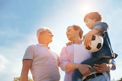Energetic healthy family gathering for a game Royalty Free Stock Photo