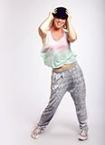 Energetic Hip Hop Dancer in Fashionable Clothing Royalty Free Stock Photography
