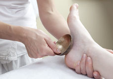 Energetic massage from foot therapy Stock Photo