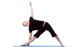 Energetic middle-aged man doing yoga poses Royalty Free Stock Photo