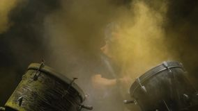 Energetic music in the performance of a professional drummer. Black background. stock video