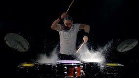 Energetic music in the performance of a professional drummer. Black background. stock video footage