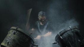Energetic music in the performance of a professional drummer. Black background. stock footage