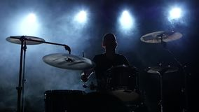 Energetic music in the performance of a professional drummer. Black smoky background. Silhouette. Slow motion stock video