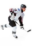 Energetic player. Portrait of energetic player playing hockey on ice royalty free stock photos