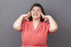Energetic plus size woman enjoying herself with cool body language Stock Images