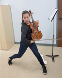 Energetic pose with violin stock photos