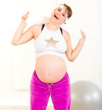 Energetic pregnant woman enjoying making sports Royalty Free Stock Images