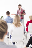 Energetic presentation by a young team leader Royalty Free Stock Photos