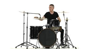 Energetic professional musician plays good music on drums. White background stock video footage