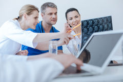Energetic radiologists examining mrt scan results at the lab Stock Photo