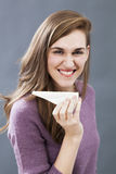 Energetic 20s girl enjoying eating milk cheese for energy and appetizing food royalty free stock photography