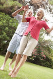 Energetic Senior Couple In Countryside Stock Image