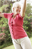 Energetic Senior Woman In Countryside Royalty Free Stock Photography