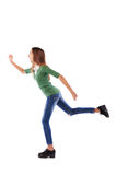 Energetic and sporty teenager in a hurry rushing forwards over w Stock Image