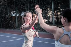 Energetic two women contesting in tennis match stock photography